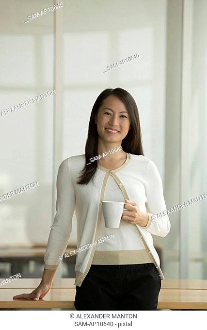 Singapore, Portrait of business woman in office