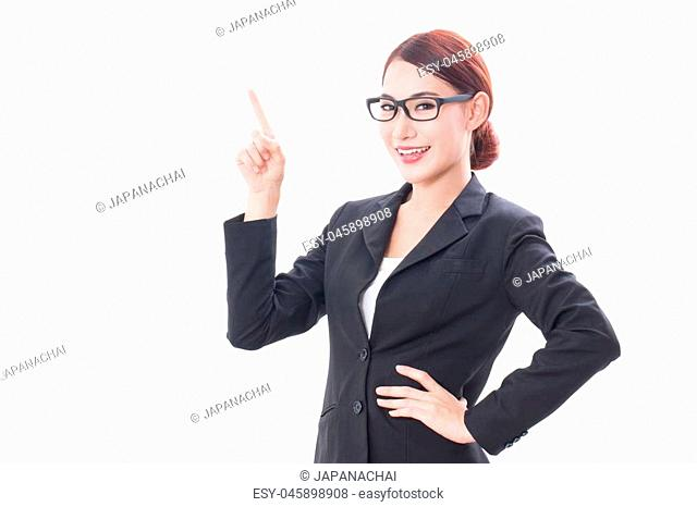 Portrait of young businesswoman wearing glasses pointing up isolated on white background