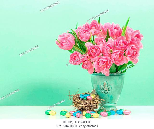 tulip flowers and pastel colored easter eggs