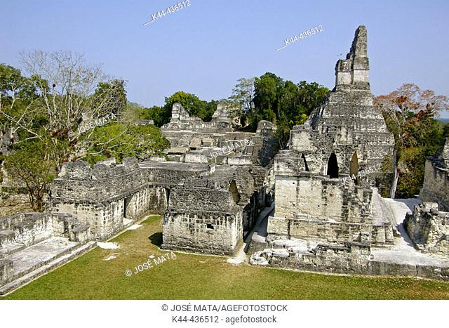 Maler Palace with Temple I and Great Jaguar in the back and North Acropolis. Mayan ruins of Tikal. Peten region, Guatemala