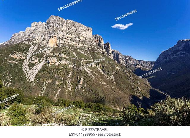 View of Vikos Gorge and natural towers of Astraka from the Vikos village in central Zagori, Greece