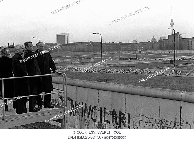 Vice President George Bush looks over the Berlin Wall into East Berlin. He is escorted by Mayor Von Weizacker and Chancellor Kohl on Bush's left . Feb