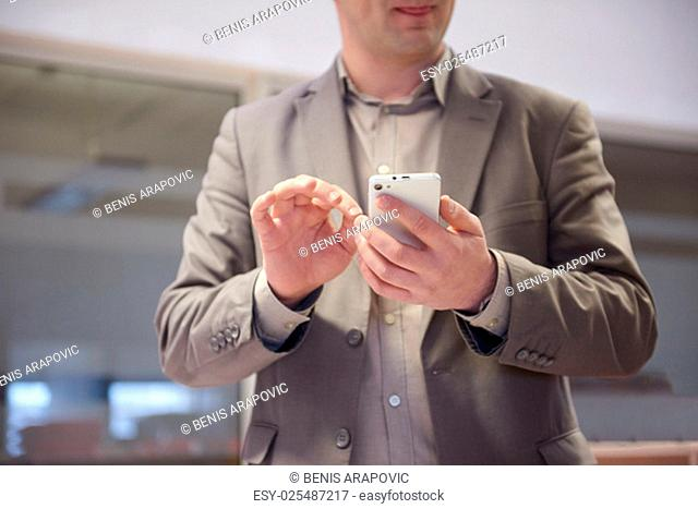 close up photo of business man work on phone at office