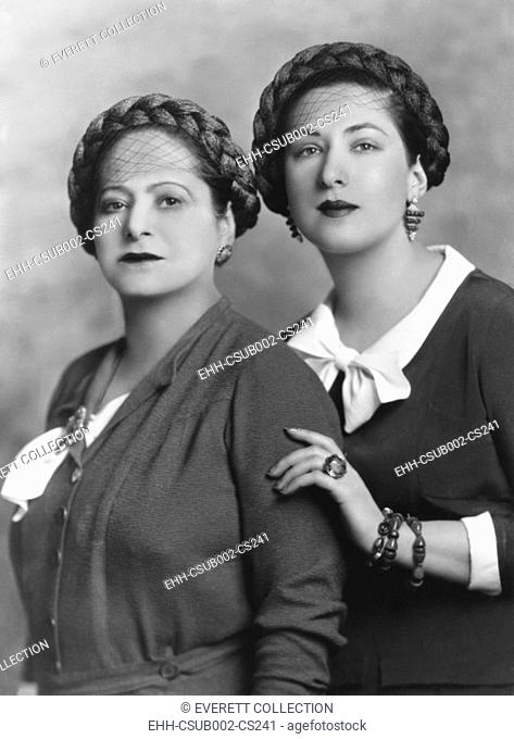 Helena Rubenstein with her 28 year old niece, Mala Rubenstein, manager of her Paris salon. Mala moved from Poland to Paris ten years earlier to learn the...
