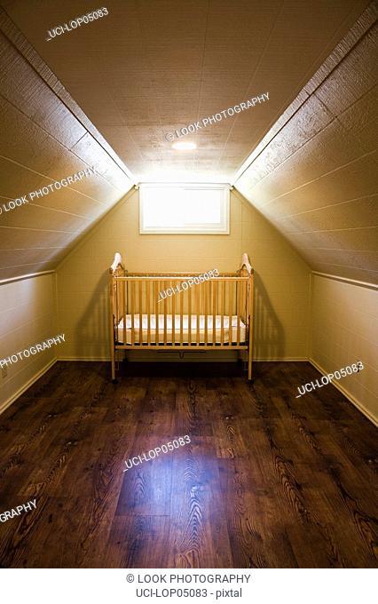 Baby's Crib Alone in Attick Room