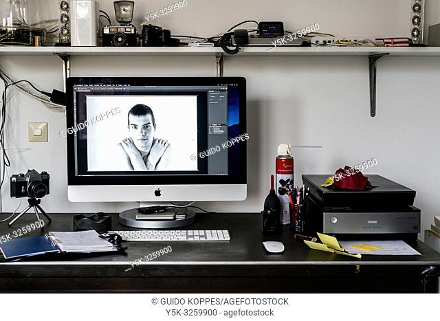 Tilburg, Netherlands. Workplace at home of a highly skilled image professional, scanning analog photo film into digital image files