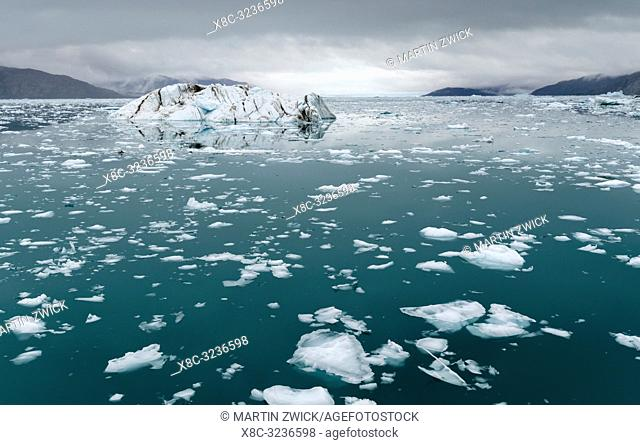 Fjord with icebergs, in the background the Eqip Gletscher (Eqip Sermia or Eqi Glacier) in Greenland. Polar Regions, Denmark, August