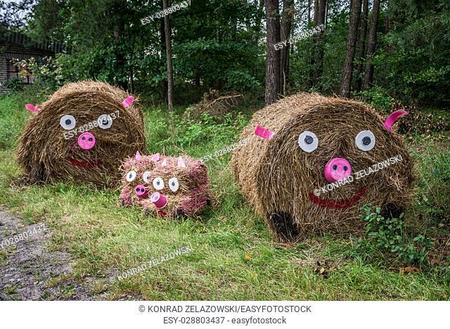 Straw bale figures made for Dozynki - Slavic harvest festival in Brusy commune, Kashubia region of Pomeranian Voivodeship in Poland