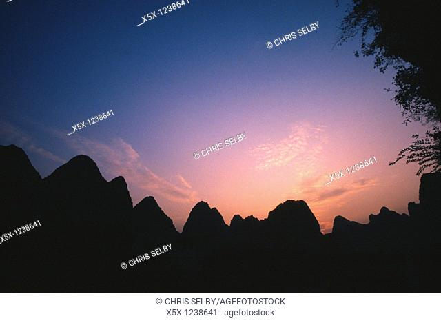 Karst mountains at sunset near Yangshou, Guangxi province, China