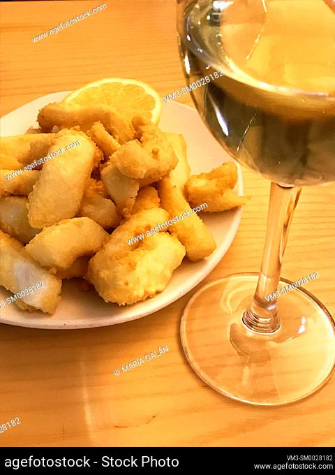 Fried squids and glass of white wine