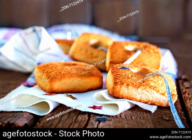 sweet cookies on napkin and on a table
