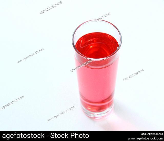 Glass of rose liquid on white background, São Paulo, Brazil