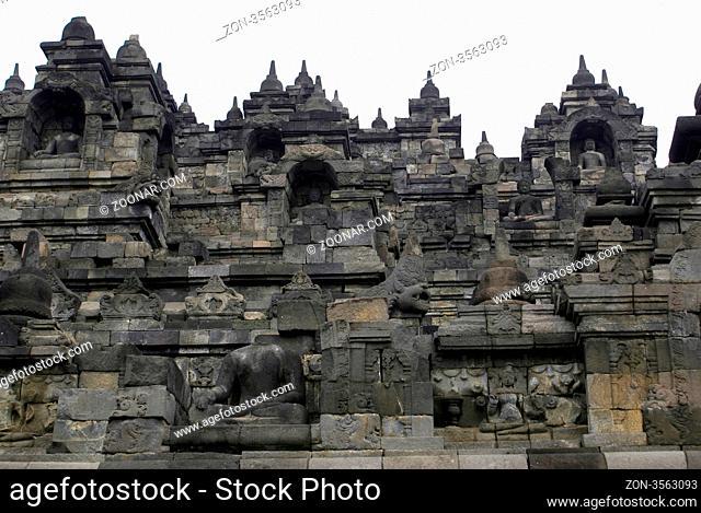 Buddhas on the wall of Borobudur, Java, Indonesia