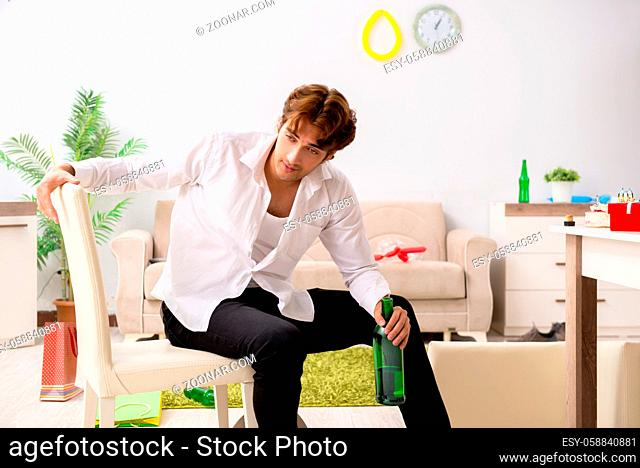 Young man having hangover after party