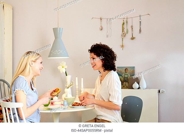 Women having breakfast together at table
