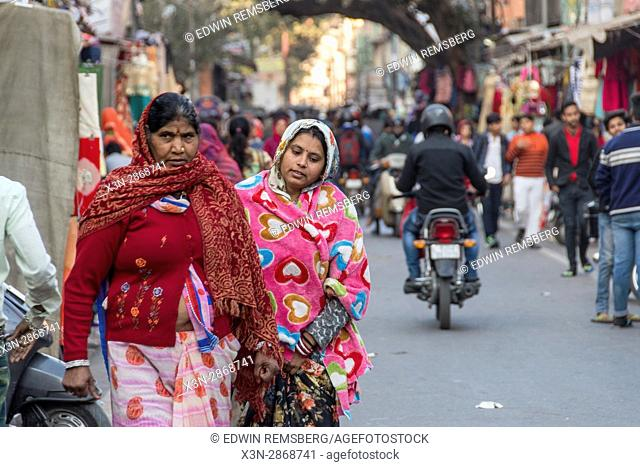 Johri Bazaar; Indian women walking down street in Jaipur, India