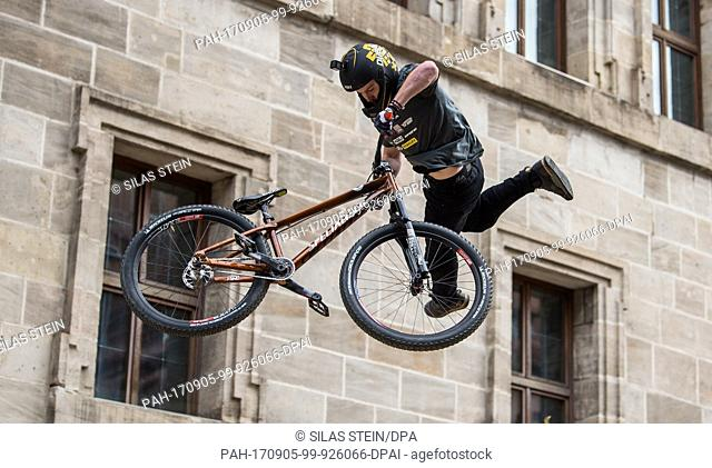 US-American mountainbiker Nicholi Rogatkin in action at the 'Red Bull District Ride' on the Hauptmarkt square in Nuremberg, Germany, 2 September 2017
