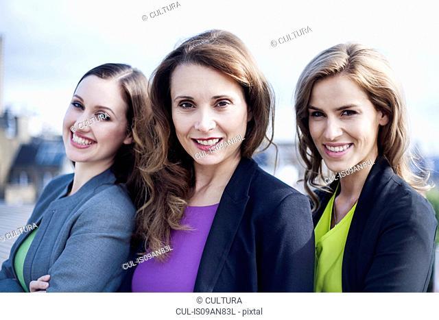 Portrait of three businesswomen, outdoors