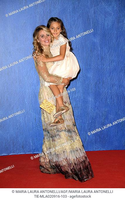 Angelica Russo, wife of Gabriele Muccino with daughter Penelope Muccino during the red carpet of film L'Estate addosso at 73rd Venice Film Festival, Venice