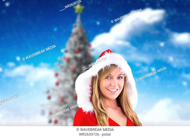Beautiful woman in santa costume smiling at camera