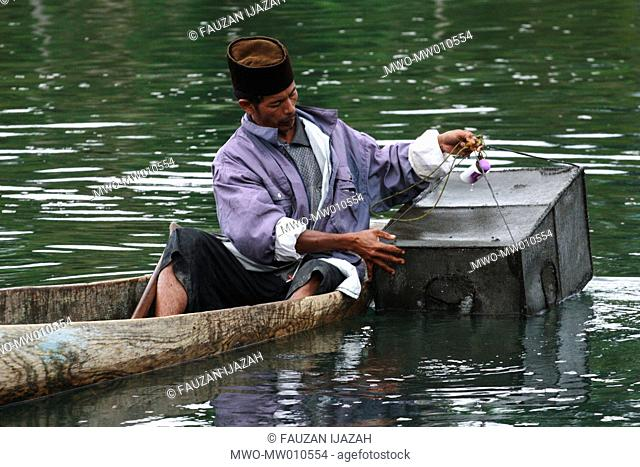 A fisherman fishing in the river at Asir Village, Takengon, Central Aceh, Indonesia August 19, 2007