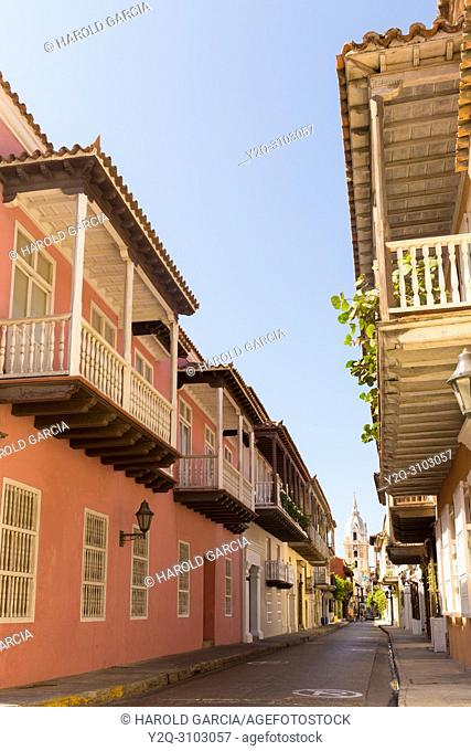 Street with colonial houses with big balconies in the ancient walled city of Cartagena de Indias. UNESCO's historical patrimony of humanity