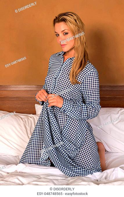 Pretty slender blonde in a blue and white check shirt dress