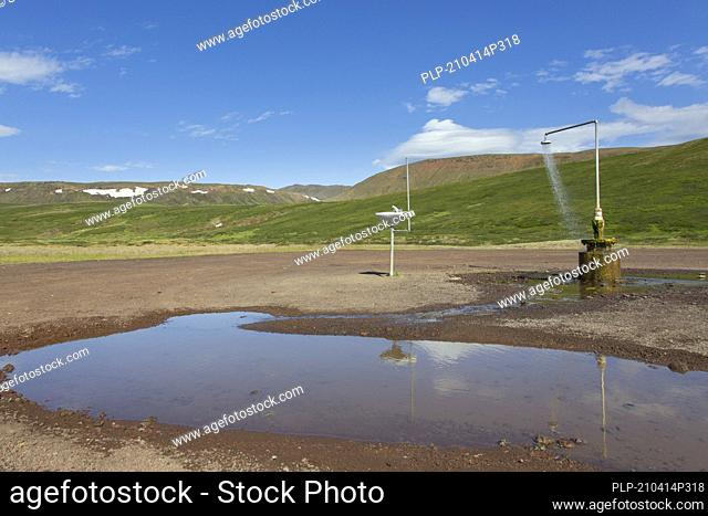 Shower and sink with hot water at Krafla, volcanic caldera in the Myvatn Geothermal Area in summer, North Iceland