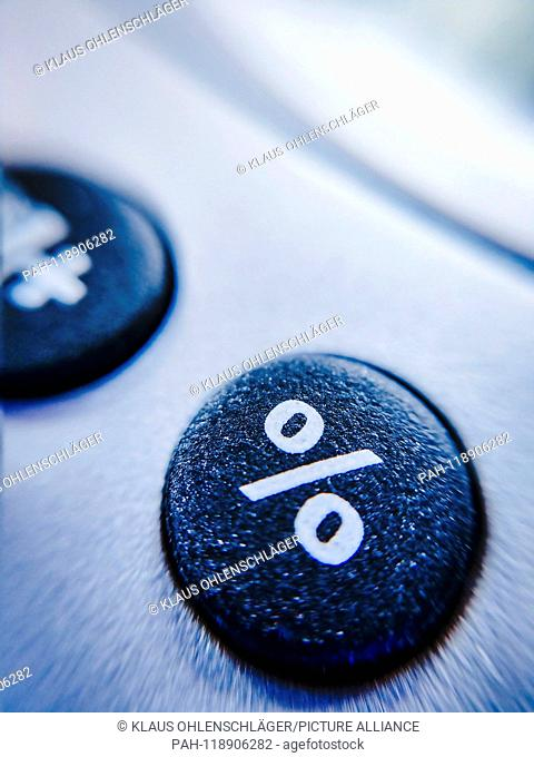 Button of a calculator with percent sign | usage worldwide