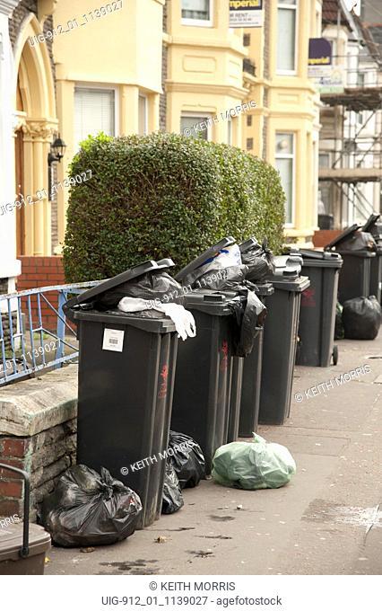 Rubbish bins outside student houses, Colum Road, Cardiff, Wales UK