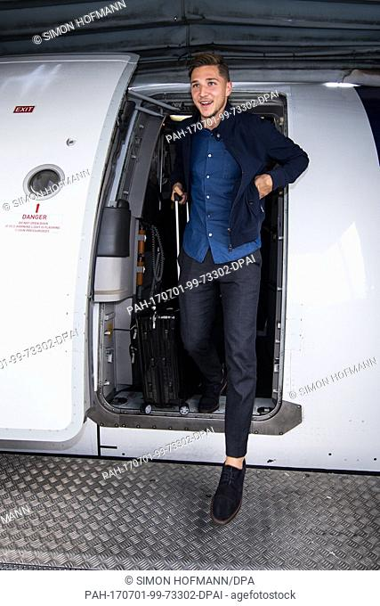 Niklas Stark departs the plane carrying the Germany U21 National Team at Frankfurt International Airport on July 1, 2017 in Frankfurt am Main, Germany