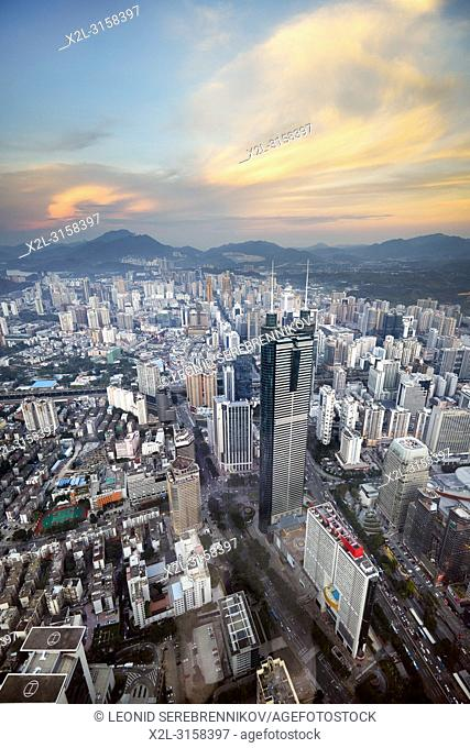 Aerial city view from the top of KK100 (Kingkey 100) skyscraper at sunset. Luohu District, Shenzhen, Guangdong Province, China