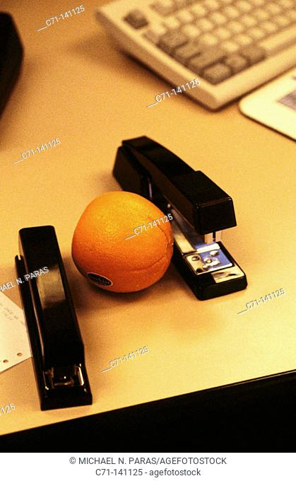 Staplers and orange