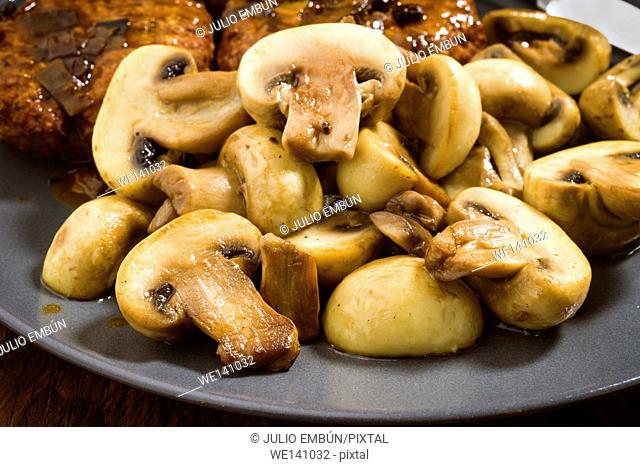 ration stewed mushrooms on wooden board
