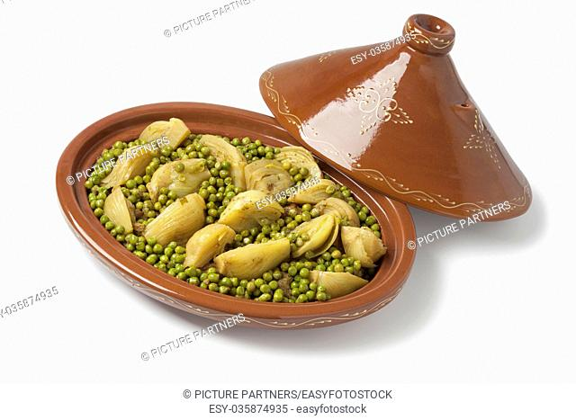 Traditional Moroccan oval tagine with meat, peas and fennel on white background