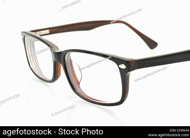 Close-up of modern eyeglasses over white background