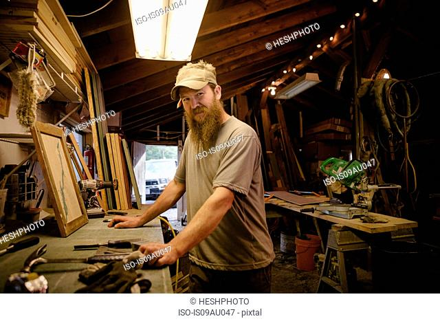Portrait of wood artist working in workshop