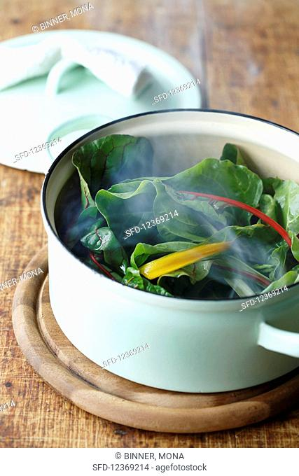 Mangold in a steamy cooking pot