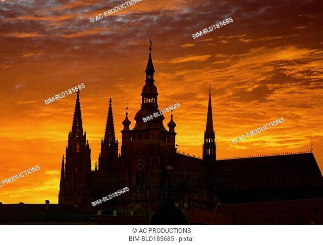 Silhouette of ornate church against sunset sky
