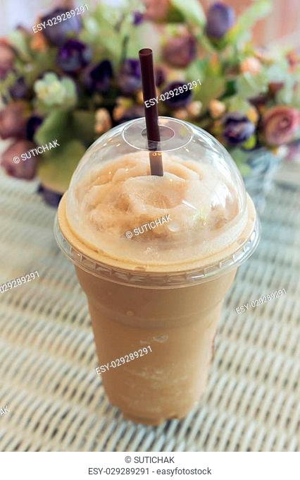 cold ice coffee drink put on table in cafe coffee shop