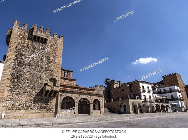 """Caceres, Spain - july 13, 2018: Main square of the city, to the right monument called """"""""Torre de Bujaco"""""""", Arab building of square plant erected on Roman..."""