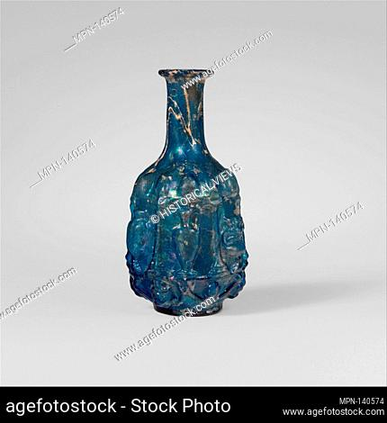 Glass hexagonal bottle. Period: Early Imperial, Julio-Claudian; Date: 1st half of 1st century A.D; Culture: Roman; Medium: Glass; blown in a three-part mold;...