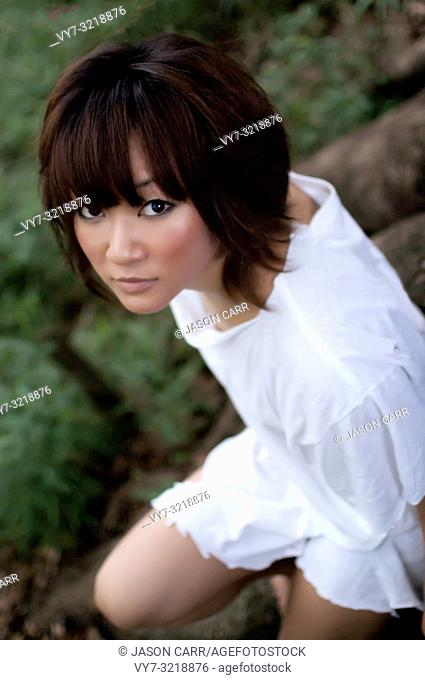 Asian female model poses for pictures in the nature
