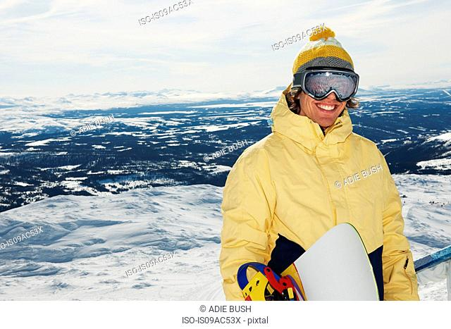 Snowboarder at the top of mountain