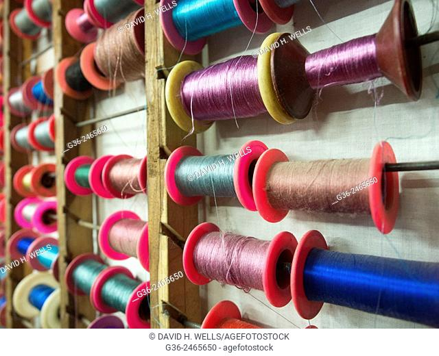 Colourful threads on rack, Varanasi, Uttar Pradesh, India