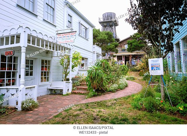 Craft stores and galleries in a courtyard in downtown Mendocino, California, famous for its historic water towers