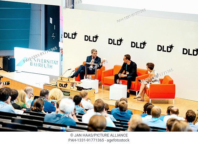 BAYREUTH/GERMANY - JUNE 21: (l-r) Prof. Dr. Thomas Scheibel (University of Bayreuth), Sam Handy (adidas) talk with Jennifer Schenker (Les Echos/The Innovator)...