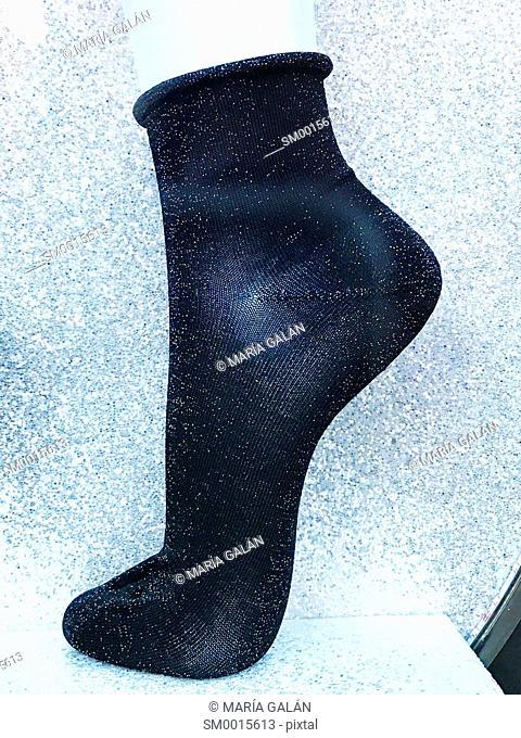 Shiny black sock in a shop window