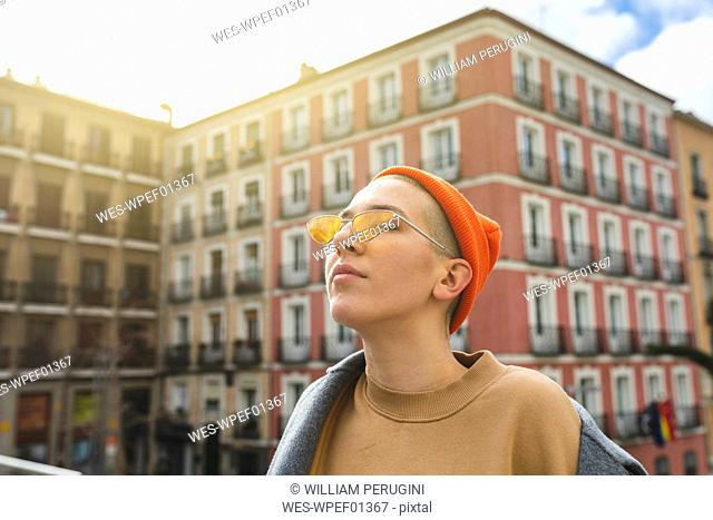 Portrait of a young woman with closed eyes in the city
