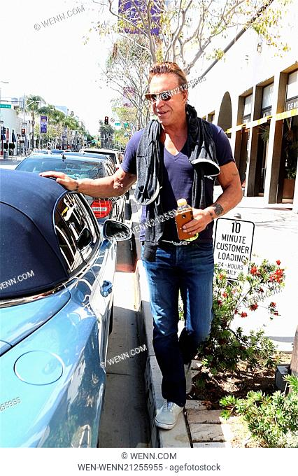 Mickey Rourke Seems To Be In Good Spirit As He Arrives At His Car Beverly